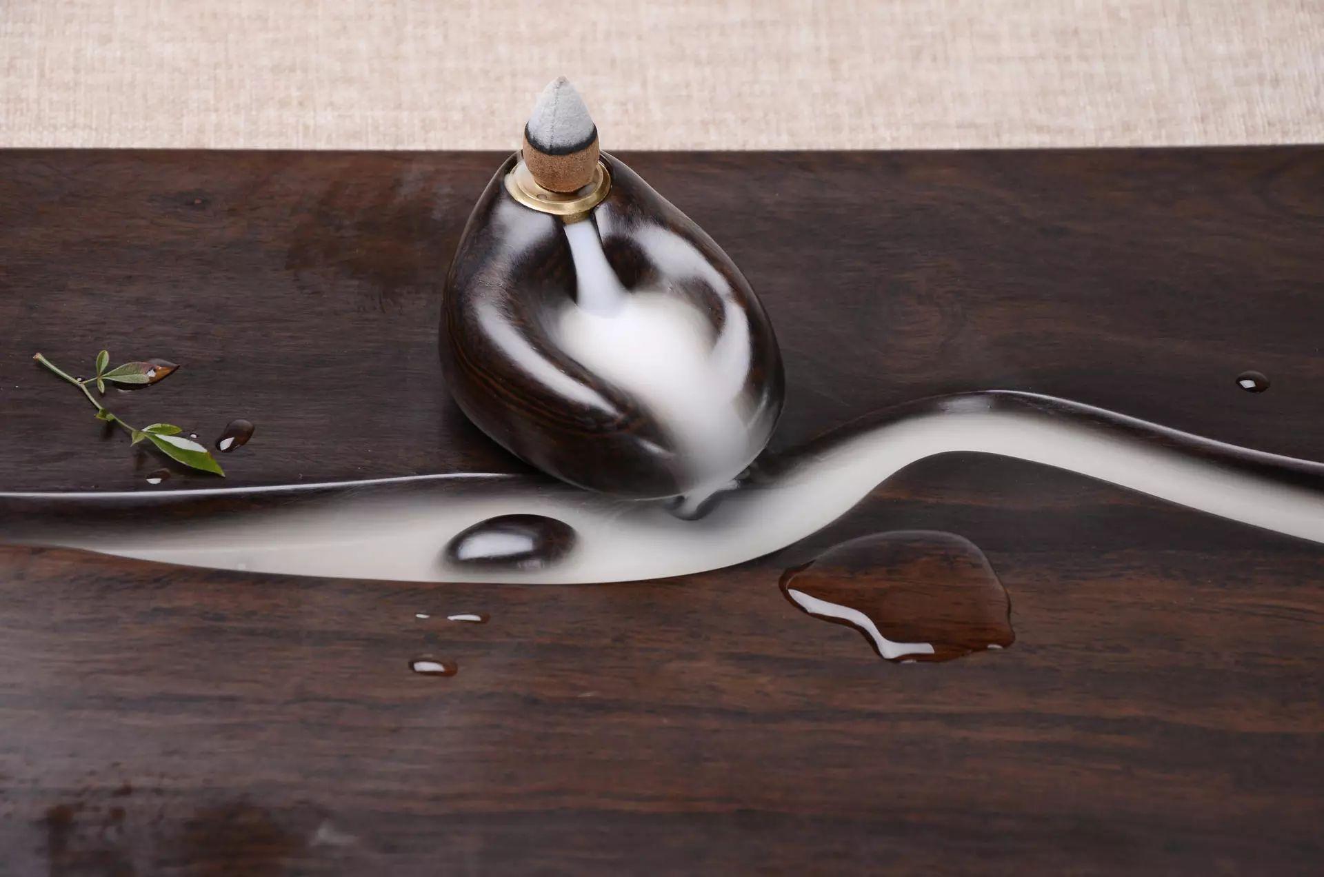 该茶盘设计不仅可以流水,也可以流香!